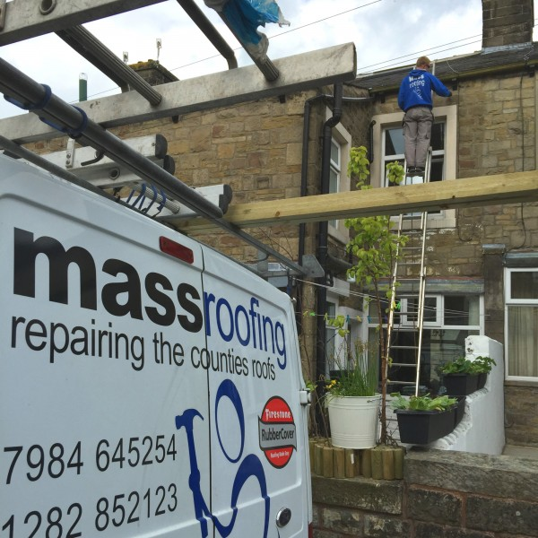 The Mass Roofing services van in Barnoldswick